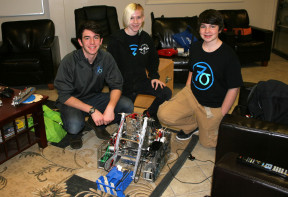 Some of the 7 Sigma team showing off their Champion robot